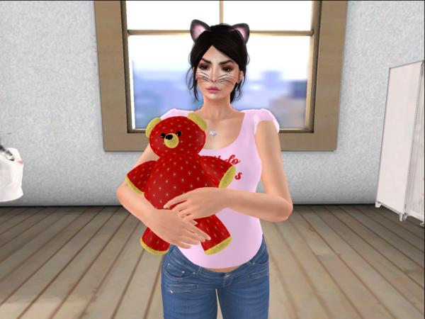 Me holding Strawberry Linden's official Linden Bear.